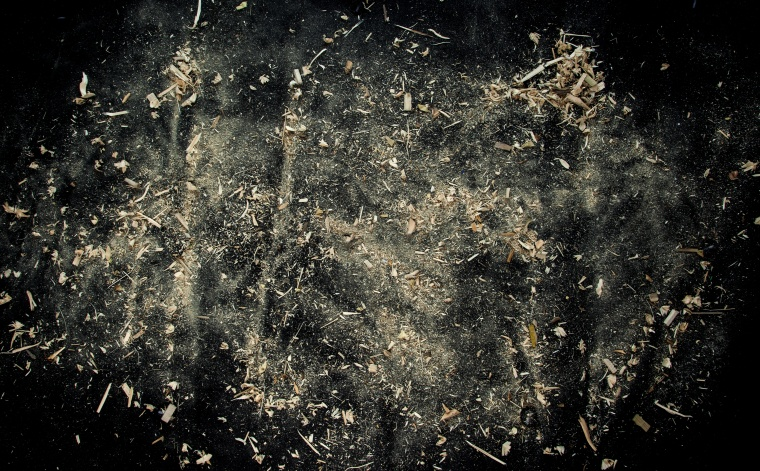 Explosion of sawdust on black background.