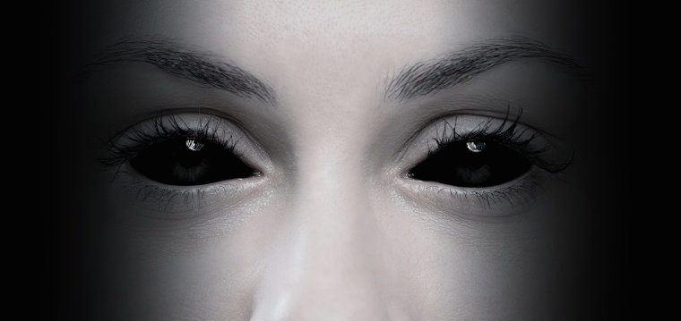 Halloween concept, close up of evil female eyes