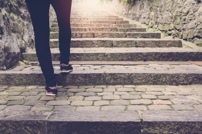 Woman walk on stair background with vintage filter