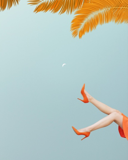 Surreal imaginary scene with a woman with her legs in the air, evening sky with quarter moon. Orange palm leaves in the background